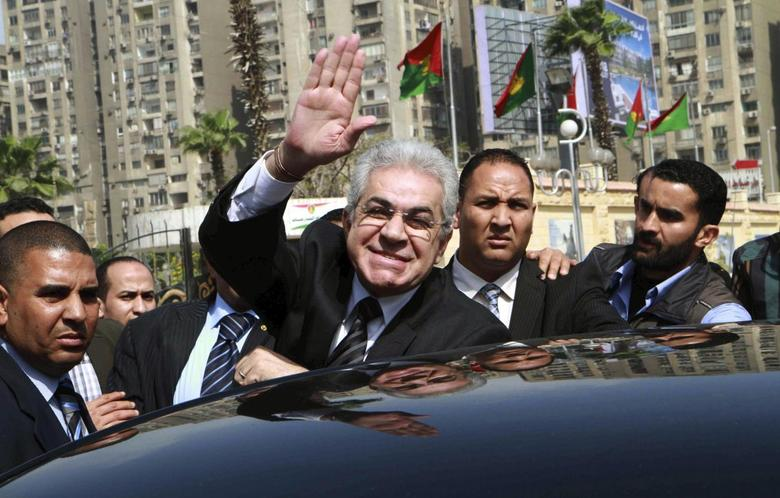 Leftist politician Hamdeen Sabahi (C) waves upon arrival to submit his bid to run as presidential candidate to the presidential election committee in Cairo, April 19, 2014. REUTERS/Al Youm Al Saabi Newspaper