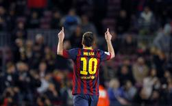 Barcelona's Lionel Messi celebrates a goal against Athletic Bilbao during their La Liga soccer match at Camp Nou stadium in Barcelona April 20, 2014. REUTERS/Albert Gea