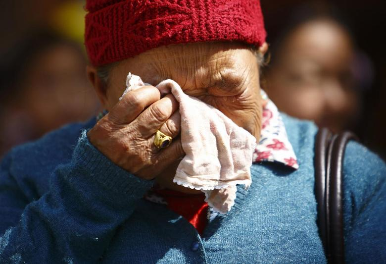The mother of Kaji Sherpa, one of 12 Nepali mountaineering guides who lost his life in an avalanche on Mount Everest, cries as she waits for the body of her son to arrive at Sherpa Monastery in Kathmandu April 19, 2014. REUTERS/Navesh Chitrakar