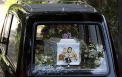 A hearse carrying the coffin of Peaches Geldof, painted with a picture of her family, arrives for her funeral service at the St Mary Magdalene and St Lawrence church in Davington, southeast England April 21, 2014. REUTERS/Neil Hall