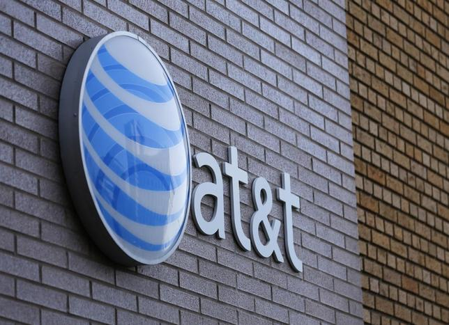 An AT&T sign is shown on a building in downtown San Diego, California March 18, 2014. REUTERS/Mike Blake