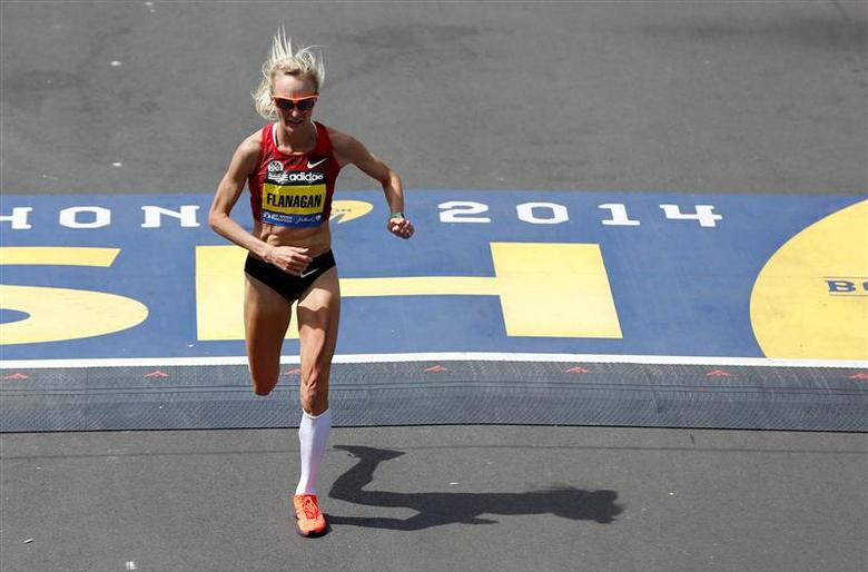 Apr 21, 2014; Boston, MA, USA; Shalane Flanagan (USA) crosses the finish line during the 2014 Boston Marathon. Mandatory Credit: Greg M. Cooper-USA TODAY Sports