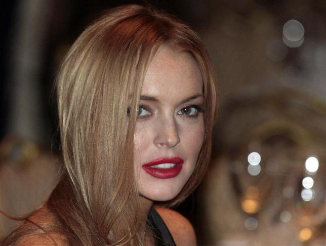 Actress Lindsay Lohan attends the White House Correspondents' Association annual dinner in Washington in this April 28, 2012 file photo. REUTERS/Larry Downing/Files