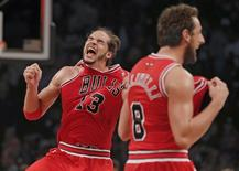 Chicago Bulls center Joakim Noah (13) and Chicago Bulls guard Marco Belinelli celebrate after they beat the Brooklyn Nets to advance to the next round in Game 7 of their NBA Eastern Conference Quarterfinals basketball playoff series in New York, May 4, 2013. REUTERS/Ray Stubblebine