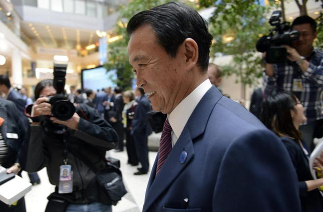 Japan's Finance Minister Taro Aso arrives for the start of the G20 ministerial meetings, during the IMF/World Bank's 2014 Spring Meetings in Washington April 11, 2014. REUTERS/Mike Theiler
