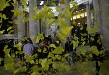 People stand outside the Palace of the Fine Arts surrounded by yellow paper butterflies after a public viewing of the ashes of late Colombian Nobel laureate Gabriel Garcia Marquez in Mexico City, April 21, 2014. REUTERS/Henry Romero