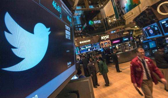 The Twitter logo is displayed on the floor of the New York Stock Exchange in this file photo taken November 8, 2013. REUTERS/Brendan McDermid/Files