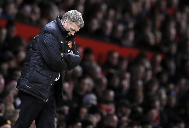 Then Manchester United's manager David Moyes reacts during their English Premier League soccer match against Swansea City at Old Trafford in Manchester, northern England in this January 11, 2014 file photo. REUTERS/Phil Noble/Files