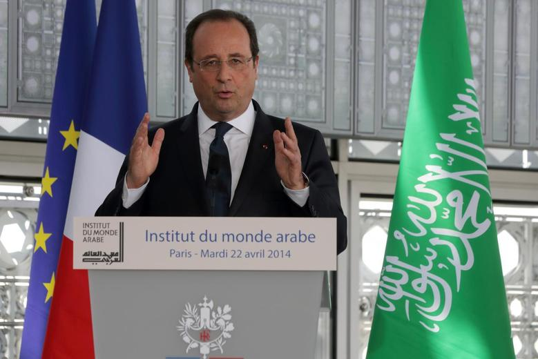 French President Francois Hollande delivers a speech during the inauguration of an exhibition on the Haj, the Islamic pilgrimage to Mecca, at the Institut du Monde Arabe (Arab World Institute) in Paris, April 22, 2014. REUTERS/Philippe Wojazer
