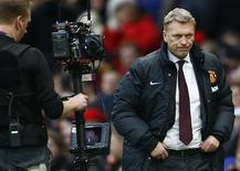 Then Manchester United's manager David Moyes reacts after losing to Newcastle United in their English Premier League soccer match at Old Trafford in Manchester, northern England, in this December 7, 2013 file photo. REUTERS/Darren Staples/Files