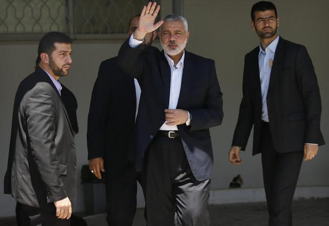 Head of the Hamas government Ismail Haniyeh waves outside his office in Gaza City April 21, 2014. REUTERS/Mohammed Salem