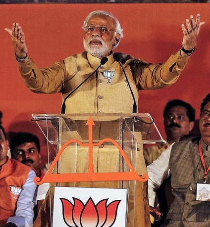 Hindu nationalist Narendra Modi, prime ministerial candidate for the main opposition Bharatiya Janata Party (BJP), gestures as he addresses an election campaign rally in Mumbai April 21, 2014. REUTERS/Danish Siddiqui