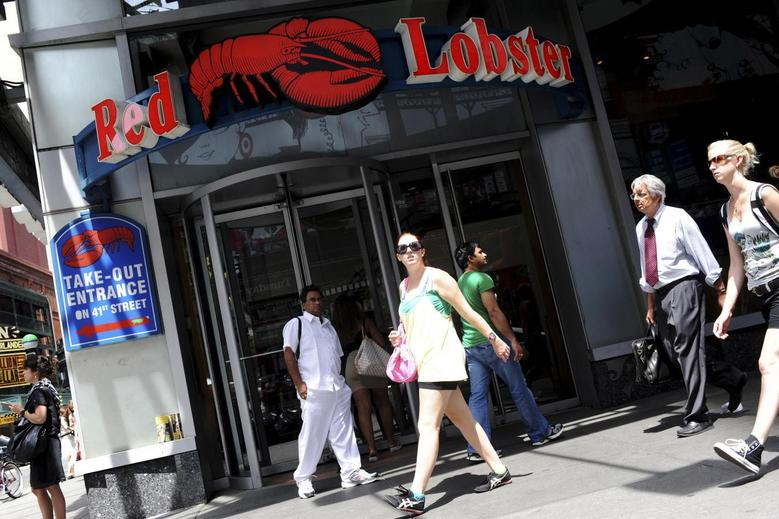 Passersby walk in front of the Times Square Red Lobster restaurant in New York, June 23, 2010. REUTERS/Keith Bedford