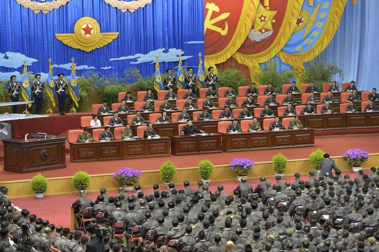 North Korean leader Kim Jong Un (front row on stage, 5th L) speaks while presiding over the first meeting of the airpersons of the Korean People's Army (KPA) in Pyongyang April 15, 2014, in this photo released by North Korea's Korean Central News Agency (KCNA) on April 20, 2014. REUTERS/KCNA
