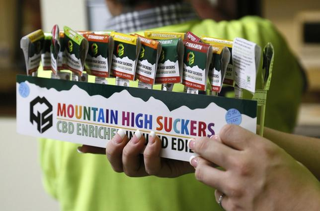 An employee brings out a display of drug-infused candies at the Botana Care marijuana store just before opening the doors to customers for the first time in Northglenn, Colorado January 1, 2014. REUTERS/Rick Wilking
