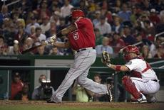 Apr 22, 2014; Washington, DC, USA; Los Angeles Angels first baseman Albert Pujols (5) hits a two-run home run during the fifth inning against the Washington Nationals at Nationals Park. This was Pujols' 500th career home run. Mandatory Credit: Tommy Gilligan-USA TODAY Sports