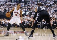 Apr 22, 2014; Toronto, Ontario, CAN; Toronto Raptors guard DeMar DeRozan (10) controls the ball against Brooklyn Nets forward Paul Pierce (34) during the first half of game two during the first round of the 2014 NBA Playoffs at Air Canada Centre. Mandatory Credit: John E. Sokolowski-USA TODAY Sports