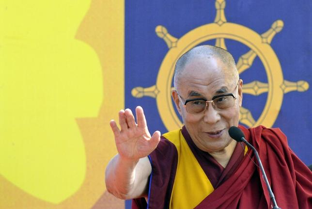 Exiled Tibetan spiritual leader, the Dalai Lama, addresses a gathering with the theme ''A Human Approach to Peace and the Individual'' at a stadium in the northeastern Indian city of Guwahati February 2, 2014. REUTERS/Utpal Baruah