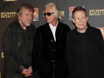 "Led Zeppelin singer Robert Plant (L), guitarist Jimmy Page (C) and bassist/keyboardist John Paul Jones pose for photographers as they arrive for the U.K. premiere of ""Celebration Day"" at the Hammersmith Apollo in London October 12, 2012. REUTERS/Suzanne Plunkett"