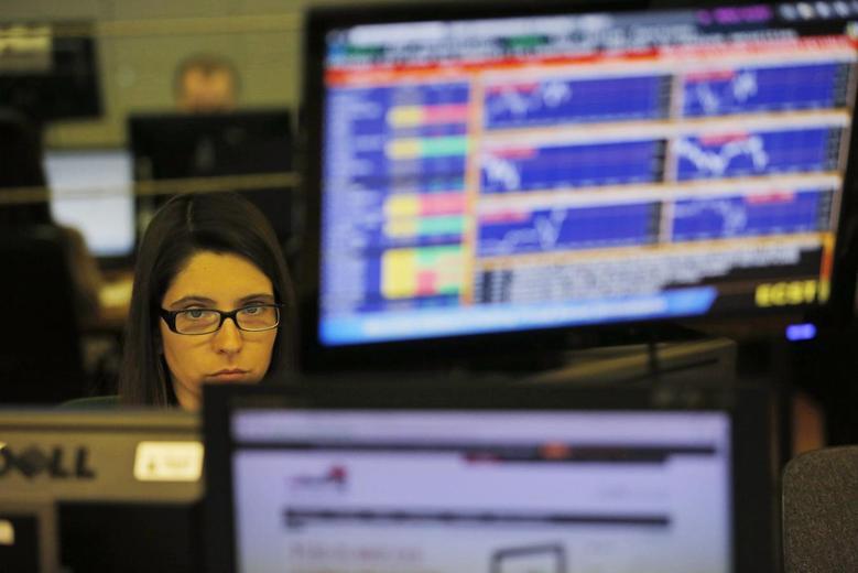 A trader looks at screens at a bank in Lisbon April 23, 2014. REUTERS/Hugo Correia