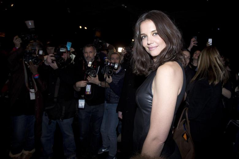 Actress Katie Holmes arrives for the Donna Karan New York show during New York Fashion Week February 10, 2014. REUTERS/Carlo Allegri