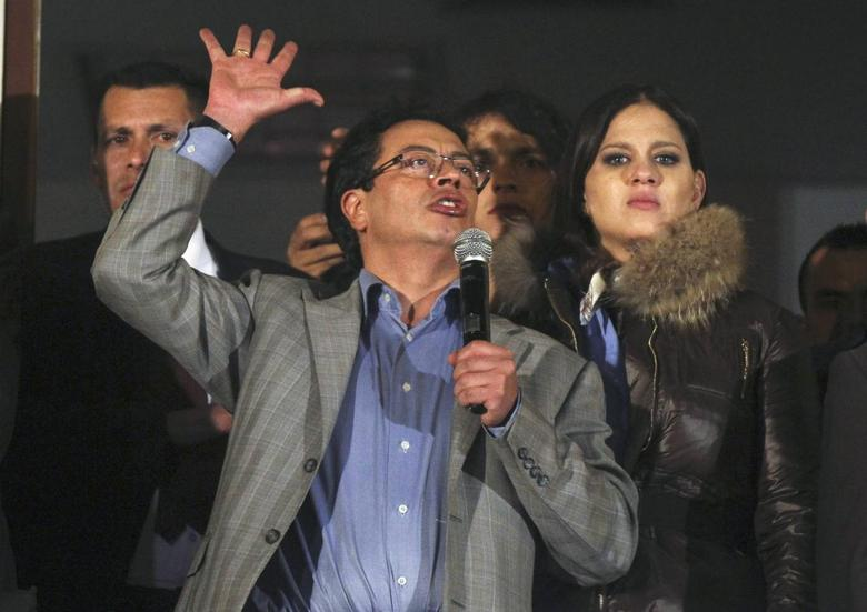 Bogota's ousted mayor Gustavo Petro gestures during a speech to supporters at the mayor building in Bogota March 19, 2014. REUTERS/ John Vizcaino