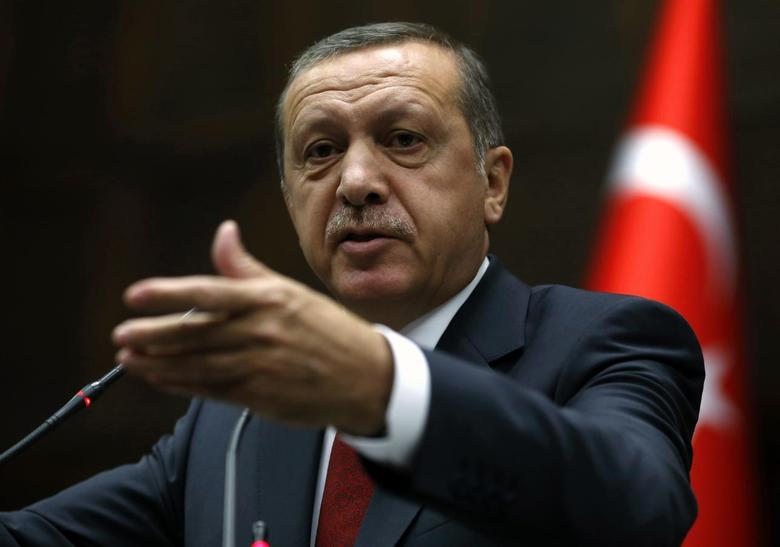 Turkey's Prime Minister Tayyip Erdogan addresses members of parliament from his ruling AK Party (AKP) during a meeting at the Turkish parliament in Ankara April 22, 2014. REUTERS/Umit Bektas