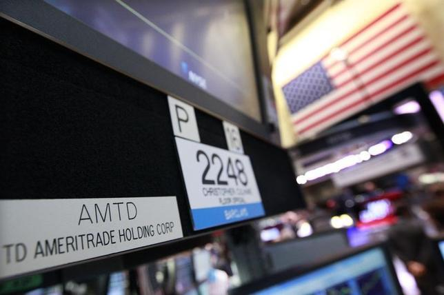 A sign with the ticker symbol for TD Ameritrade is seen at the trading post that trades the company on the floor of the New York Stock Exchange, April 25, 2012. REUTERS/Brendan McDermid