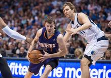 Apr 12, 2014; Dallas, TX, USA; Phoenix Suns guard Goran Dragic (1) drives to the basket past Dallas Mavericks forward Shawn Marion (0) and forward Dirk Nowitzki (41) during the first quarter at the American Airlines Center. Jerome Miron-USA TODAY Sports