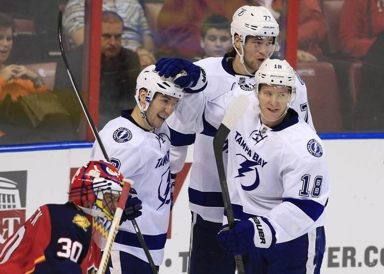 Dec 23, 2013; Sunrise, FL, USA; Tampa Bay Lightning center Tyler Johnson (9) celebrates his goal against Florida Panthers goalie Scott Clemmensen (30) with left wing Ondrej Palat (18) and left wing Ondrej Palat (18) in the second period at BB&T Center. Robert Mayer-USA TODAY Sports
