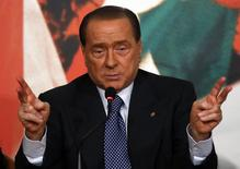 Forza Italia leader Silvio Berlusconi gestures during a meeting in Rome, April 17, 2014. Former primer minister Berlusconi presented candidates for the next European Union elections during the meeting. REUTERS/Remo Casilli