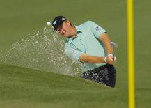 South Africa's Ernie Els hits from the sand on the second hole during the second round of the Masters golf tournament at the Augusta National Golf Club in Augusta, Georgia April 11, 2014. REUTERS/Brian Snyder