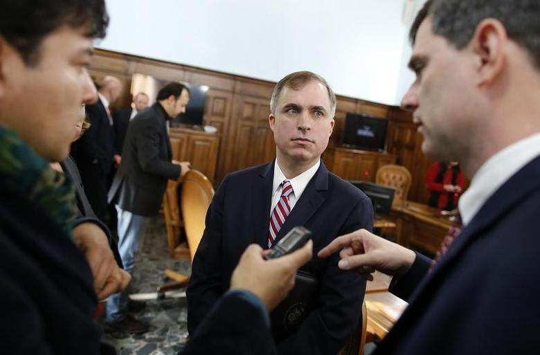 U.S. prosecutors Marshall Miller (C) and William Nardini (R) talk with a reporter at the end of a news conference in Rome February 11, 2014. REUTERS/Tony Gentile