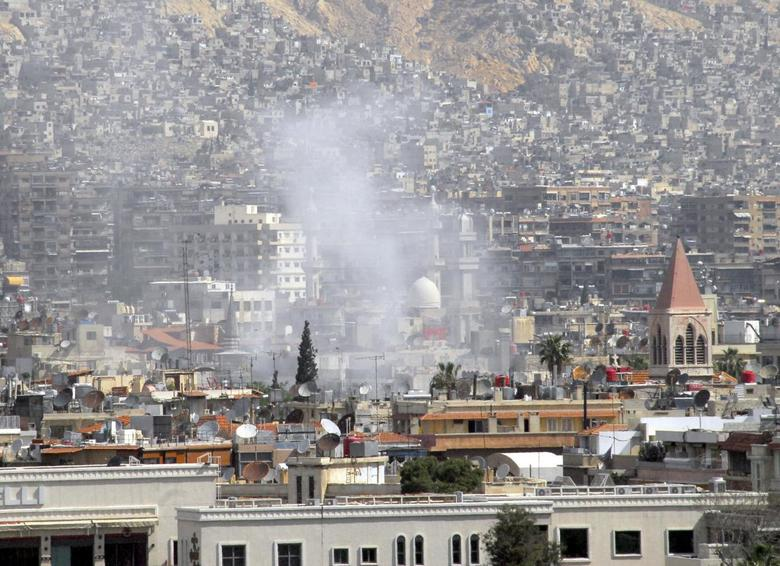 A view shows smoke rising after mortar bombs landed on a neighborhood in Damascus April 21, 2014, in this handout photograph released by Syria's national news agency SANA. REUTERS/SANA/Handout via Reuters