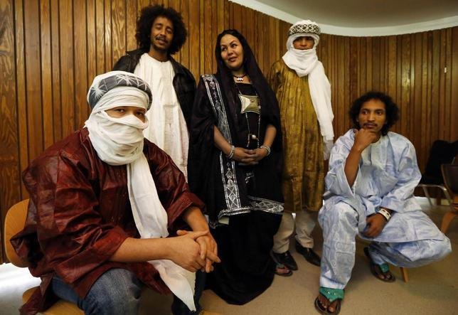Mali's Cheikh Ag Tiglia, Ousmane Ag Mossa, Wonou Walet Sidati, Ibrahim Ag Ahmed Salem, and Aghaly Ag Mohammedi (L-R) of the Touareg desert blues band Tamikrest, pose at Barbican Hall before the Sahara Soul concert in London in this January 26, 2012 file photo. REUTERS/Luke MacGregor/Files