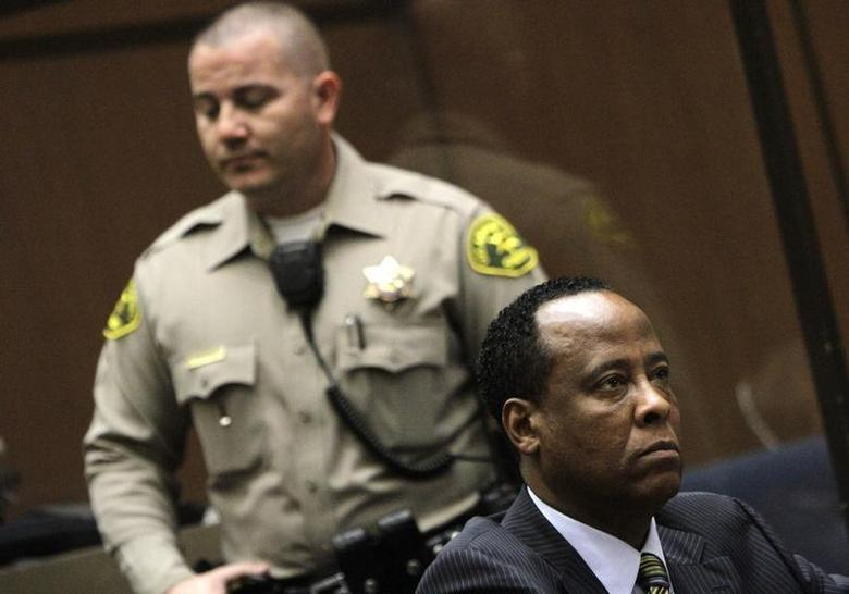 Doctor Conrad Murray (R), the late Michael Jackson's personal physician, listens during his arraignment on a charge of involuntary manslaughter in the pop star's death, in Los Angeles, California, January 25, 2011. REUTERS/Pool/Irfan Khan