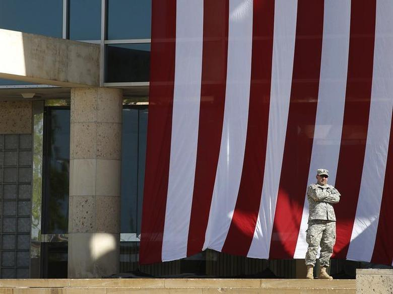 A soldier stands outside the venue for a memorial service on Sadowski Field at III Corps Headquarters for the victims of last Wednesday's shooting incident at Fort Hood, Texas April 9, 2014. REUTERS/Julia Robinson
