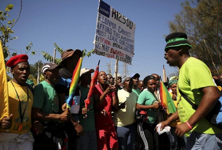 Striking miners chant slogans as they march to Lonmin's head quarters in Johannesburg, April 3, 2014. REUTERS/Siphiwe Sibeko
