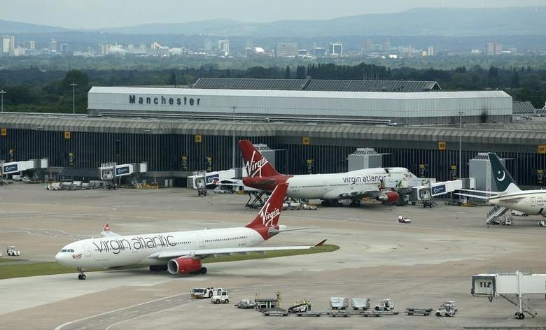 Virgin Atlantic aircraft taxi across the tarmac at Manchester Airport at Manchester Airport, northern England June 25, 2013. REUTERS/Phil Noble