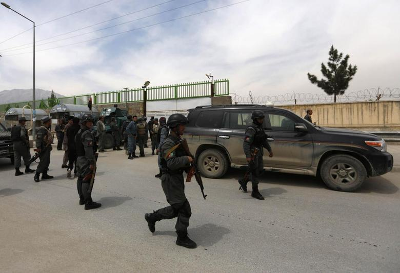 Afghan policemen secure the area outside Cure Hospital after three foreigners were killed in Kabul April 24, 2014. REUTERS/Mohammad Ismail