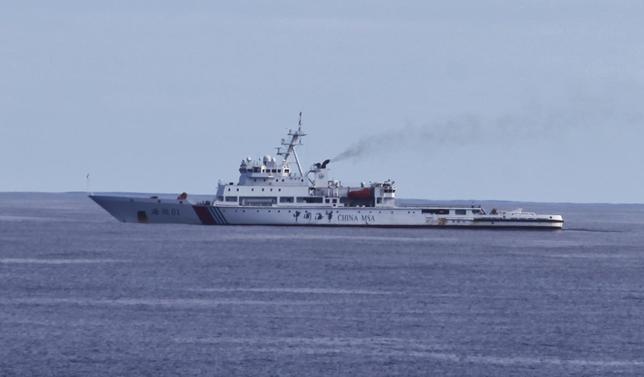 4月23日、マレーシア航空機の捜索に軍艦などを派遣する中国。そこで露呈したのは、海外基地や友好港の不足という「弱点」だ。写真は中国の巡視船。15日撮影(2014年 ロイター/CNSphoto)