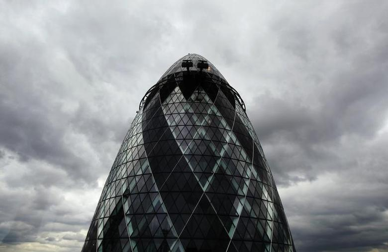 Dark clouds gather over 30 St. Mary Axe, formerly known as the Swiss RE building and also known as the Gherkin, in London August 12, 2010. REUTERS/Luke MacGregor