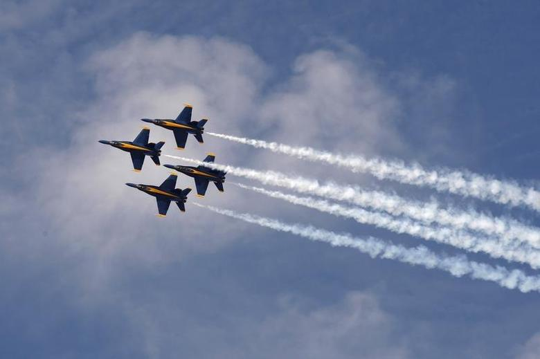 The U.S. Navy Flight Demonstration Squadron, the Blue Angels, practice their routines in F/A-18 Hornet fighter jets on rehearsal day for the Los Angeles County Air Show, where they will be the headline act, at the General William J. Fox Airfield in Lancaster, California, March 20, 2014. REUTERS/David McNew