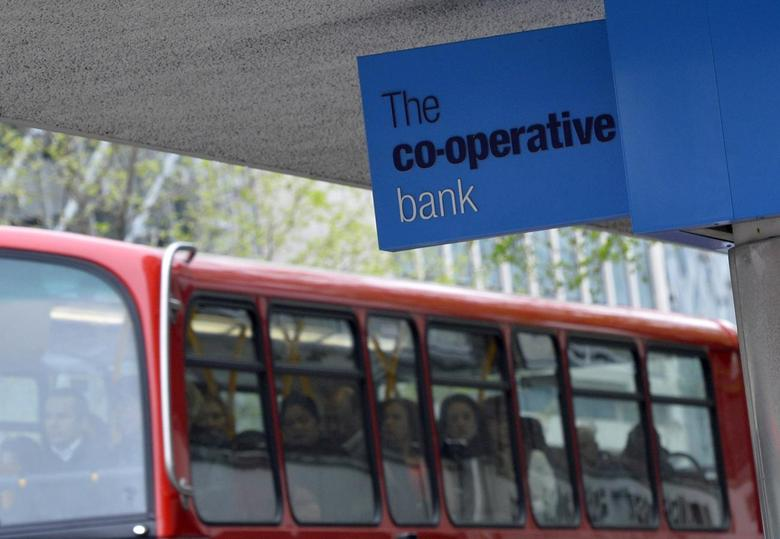 Passengers on a London bus pass a branch of the Co-operative bank in central London April 11, 2014. REUTERS/Toby Melville