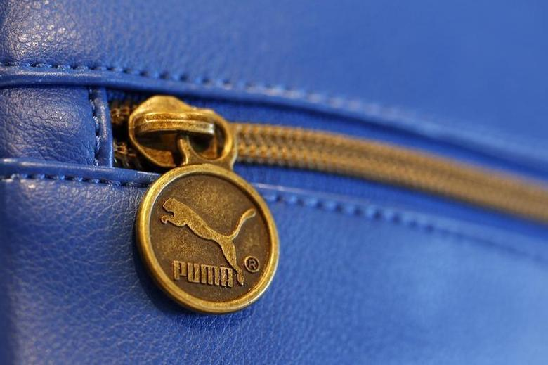 A handbag with the logo of German sports goods firm Puma is pictured in a shop after the company's annual news conference in Herzogenaurach February 20, 2014. REUTERS/Michaela Rehle