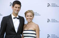 Serbian tennis player Novak Djokovic and his girlfriend Jelena Ristic pose for photographers as they arrive at a fundraising dinner for the Novak Djokovic Foundation in London July 8, 2013. REUTERS/Neil Hall