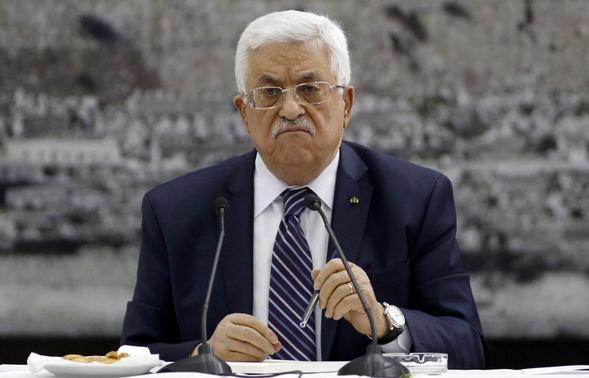 Palestinian President Mahmoud Abbas attends a meeting with Palestinian leaders in the West Bank city of Ramallah in this April 1, 2014 file picture. REUTERS- Mohamad Torokman-Files