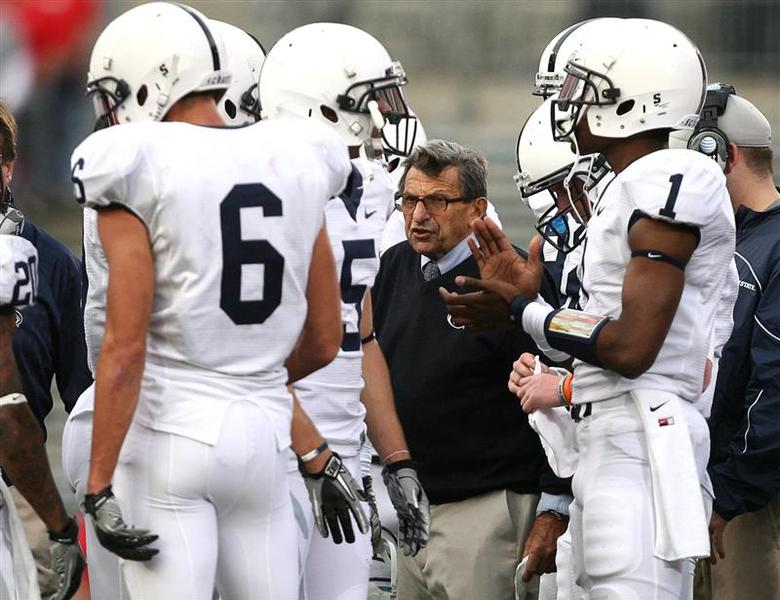 Penn State head coach Joe Paterno (C) coaches his team against Ohio State during the second quarter of their NCAA football game in Columbus, Ohio, in a November 13, 2010 file photo. REUTERS/Matt Sullivan