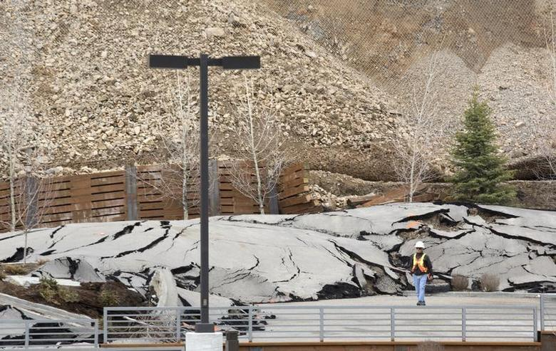 A slow moving landslide buckles the pavement of a new drugstore parking lot in Jackson Hole, Wyoming April 18, 2014. REUTERS/ David Stubbs
