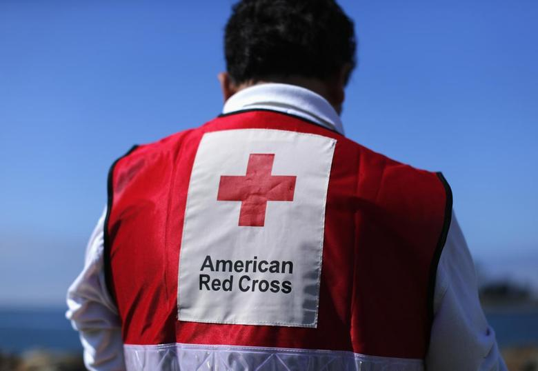 An American Red Cross official participates in a mock rescue drill simulating a boating accident in waters off the coast of San Diego, California March 5, 2014. REUTERS/Mike Blake